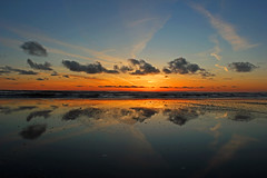 Just in time... (John Ibbotson (catching up!)) Tags: ocean sunset sea sun reflection beach water wales clouds reflections coast seaside waves tide ceredigion borth
