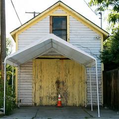 Triangles (BradPerkins) Tags: trafficcone abandoned building yellowdoors abandonedhouse missoula house odd cone siding montana yellow awning triangles