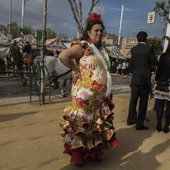 Faralaes (Julio Lpez Saguar) Tags: juliolpezsaguar urban urbano calle street ciudad city gente people sevilla seville andaluca espaa spain persona mujer woman feria abril faralaes vestido dress