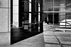 Life in a Box (draketoulouse) Tags: chicago rivernorth street streetphotography people reflection shadow glass window blackandwhite monochrome architecture grand state illinois outdoor city
