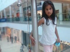 Hope (esala.kaluperuma) Tags: child girl high cross leicester leicestershire shopping esala kaluperuma uk photograph asian art serene kid hope emotions