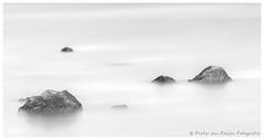 The floating rocks. (PvRFotografie) Tags: longexposure blackandwhite holland water river blackwhite rotterdam rocks zwartwit nederland nd steen stenen rivier rotterdamzuid sony70200mmf28g sonyslta99 bw110mrcfprondfilter