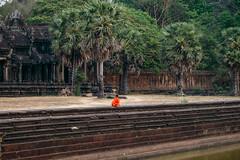 Monk before Angkor Vat. Cambodge (courregesg) Tags: building art history architecture asia cambodge traditional culture monk unesco palais monuments ethnic civilisation patrimoine ruines vestiges historicalplace asiedusudest ethnographie siteremarquable