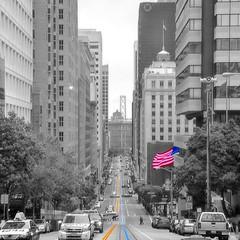 (suitoffexpo) Tags: goldengatebridge bridge flag financialdistrict downtown grey blackwhite blackandwhite blue yellow rail tram trams bw westcoast west usa california ca sanfrancisco sf