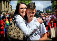 A mother's pride ... (* RICHARD M (Over 5 million views)) Tags: street portraits portraiture streetportraits streetportraiture amotherspride motherandson smiles happy happiness liverpoolpride gaypride amotherslove hugs joy july summer summertime liverpool merseyside europeancapitalofculture capitalofculture unescocityofmusic unescoworldheritagesites pride happyfamilies maternalism teenager teenageboy youth adolescence adolescent lgbt prideandjoy crowds unconditionallove truelove heartwarming proudmum teens together togetherness families familylife liverpudlians scousers minorities
