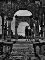 the girl with the big hat (SM Tham) Tags: asia indonesia bali island karangasem amlapura tamanujong waterpalace watergardens gardenstosee pavilion building ruin gardenfolly steps arches columns people blackandwhite monochrome outdoors