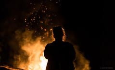From the Flames (pooshda) Tags: fire woman silhouette bonfire flame heat warm rimlight backlight back rear dark shadow dramatic festival peace peacefest michigan night noir lowlight dof mystery ambience drama sony alpha a7rii zeiss 55mm