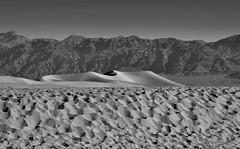 Sand Dunes and Far Off Mountains (Black & White, Death Valley National Park) (thor_mark ) Tags: amaragosarange blackwhite blueskies capturenx2edited colorefexpro day4 deathvalleynationalpark desertlandscape dunes greatbasinranges lookingnorth mesquiteflatsanddunes mountains mountainsindistance mountainsoffindistance nature nikond800e project365 sand sanddunes triptodeathvalleyandcalifornia westgreatbasinranges california unitedstates