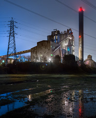 Aberthaw Cement Plant (welshio) Tags: southwales wales reflections dark lights factory nocturnal kilns pipes cables lensflare mysterious monstrosity pylons bluecircle industrialplant heavyindustry powercables cementworks industryatnight illuminatedstructure aberthawcementplantatnight