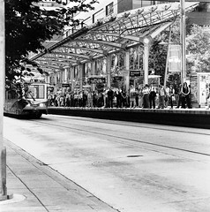 Train crowd (christait) Tags: street canada calgary station waiting crowd tracks hasselblad busy alberta transit delays yyc ctrain ilforddelta3200 500cm 7ave rodinal11002hrsstand blazinal11002hrsstand