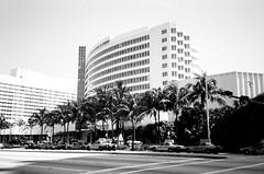 Fontainebleau Hotel Miami Beach (Phillip Pessar) Tags: white black building film beach architecture century florida zoom kodak miami district infinity trix olympus mimo x historic morris tri 70 mid 20th midcentury lapidus tx400