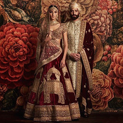 Marriage, Indian Style (JamesGoblin) Tags: marriage woman men women man bride brides husband wife husbands wives wifes couple india indian ceremony clothes red background bird birds flower flowers jewels jewel gold golden trinkets trinket piercing piercings hand hands face faces figure figures standing outfit skirt veil rich