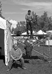 Levels (Sherlock77 (James)) Tags: calgary expolatino festival streetphotography people man scaffold camera