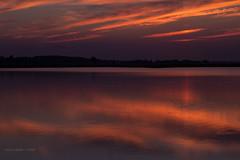 Immensity of Light (jackalope22) Tags: sunset long exposure orange blue reflections