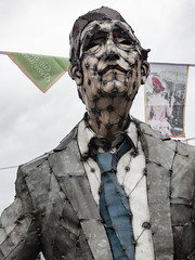 Remembering Avonside Drive (Steve Taylor (Photography)) Tags: art sculpture muted earthquake 22february2011 damage demolition liquefaction quake redzone sad metal cloth man newzealand nz southisland canterbury christchurch cbd city avonsidedrive bunting hannahkidd mall restart steelrodcorrugatediron welds watering tie suit shirt wow