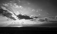 The sun sparkles on Burdur lake (VillaRhapsody) Tags: road sunset bw lake monochrome weather clouds evening driving roadtrip iphone burdur challengeyouwinner