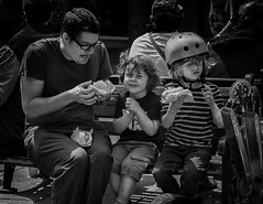 hot dog anticipation (Daz Smith) Tags: city portrait people urban bw streets boys smiling canon blackwhite bath dad sitting eating candid fastfood citylife thecity streetphotography hotdogs anticipation canon6d dazsmith bathstreetphotography