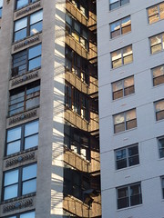(TheMachineStops) Tags: outdoor nyc manhattan newyorkcity westvillage shadows fireescape 2013 building windows architecture highrise