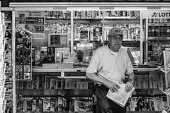 habits (fritz.brunner.1988) Tags: newspaper old man ritual habit habits black white munich mnchen street