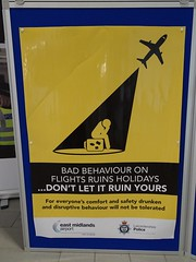Crying in the shadows (stevenbrandist) Tags: yellow left behaviour alcohol drunk drink police leicestershire eastmidlandsairport sign notice stickman