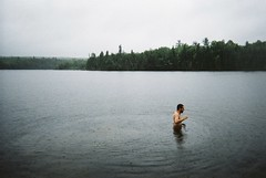 (Karsten Fatur) Tags: portrait model malemodel man naked nude nudemodel skinnydip skinnydipping lake water swim summer rain landscape nature ripples waves cloudy forest woods gay lgbt lgbtq queer queerart homoart film 35mm vintage analogue disposablecamera