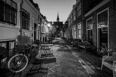 Church Street (McQuaide Photography) Tags: haarlem noordholland northholland netherlands nederland holland dutch europe sony a7rii ilce7rm2 alpha mirrorless 1635mm sonyzeiss zeiss variotessar fullframe mcquaidephotography lightroom adobe photoshop tripod manfrotto light licht night nacht nightphotography stad city urban lowlight architecture outdoor outside illuminated street straat kerkstraat backstreet window wideangle wideanglelens groothoek building longexposure church kerk nieuwekerk blackandwhite blackwhite bw mono monochrome atmosphere deserted nopeople shadow schaduw bicycle bike fiets vijfhoek cobblestone cobbledstreet oldstreet old oud character traditional authentic house