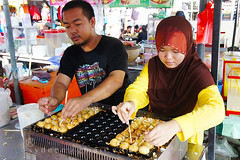 food street vendor (sydeen) Tags: travel woman man male tourism cooking kitchen shop asian cuisine asia market pair small cook tourist meat east business exotic chef malaysia destination che local fried seller kota yeh kelantan bharu wakaf