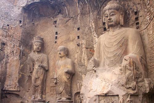 Vairocana (卢舍那大像龛, lú shě nà dà xiàng kān), Ananda and a bodhisattva, Ancestor Worshipping Temple (奉先寺, fèng xiān sì)