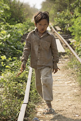 Little boy with a powerful look (T_Schildbach) Tags: street boy portrait train canon photography asia cambodia child sigma bamboo southeast battambang norry