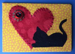 Home is where the cat is... (witt0071) Tags: red black yellow atc cat blackcat beads heart swap handstitching veryberry