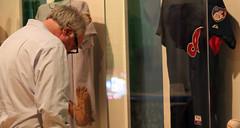 Michael Siegal looking at Justine Siegal's display in 'Chasing Dreams'