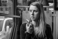 Amazement (Tomas.Kral) Tags: street bw woman public girl monochrome train fuji phone czech prague transport streetphotography tram fujifilm streetphoto cz bnw iphone xseries xphotographer x100s