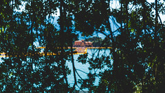 Through the leafs (Nicola Pezzoli) Tags: blue people italy mountain lake art tourism nature water colors yellow canon reflections island design piers floating monte bergamo brescia lombardia isola iseo sulzano