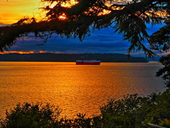 1 Ship @Sunset (poem below) (Robert Cowlishaw (Mertonian)) Tags: canonpowershotg7xmarkii canon powershot g7x mark ii mertonian robertcowlishaw sunset dusk ship water puget sound pugetsound yellow orange reflection fire