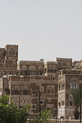 IMG_1567 copy (mariatarasoff) Tags: sanaa yemen old ancient yemeni mud brick stone architecture adobe decorative unheritagesite un streets facade red white primitive arab arabia arabian countryside landscapes relief brown window arch archway traditional sky blue patterns clouds