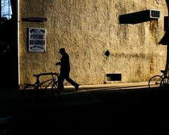 Psychic Illumination (c. Melon Images) Tags: street city winter light shadow sun man art philadelphia silhouette sign warm fuji teddy general walk candid fineart story daryl philly 2015 23mm fujix100s