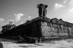 IMG_6717 East Mebon Temple (otaphoto1) Tags: sky blackandwhite cloud elephant tree monochrome grass stone wall architecture landscape temple cambodia ruin mebon laterit canon70d otaphototours