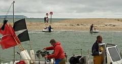 WorkAndPlay (Hodd1350) Tags: sea christchurch people men water sand fishermen olympus flags shore isleofwight dorset males jetski floats mudeford penf mudefordquay zuikolens
