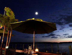 dinner with a view (-gregg-) Tags: night clouds moon palm trees umbrella water bay kent island sky