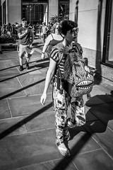 (Damien Sass) Tags: streetphotography america newyorkcity blackandwhite bw bigapple beenthere manhattan midtown camera fifthavenue fujifilm xpro2 rockefeller 28mm 2016 urban usa unitedstates backpack mouth teeth woman