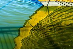abstract reflection of the bow of Darken Harald Harfagre (TAC.Photography) Tags: reflections vikingship waterreflections tallshipfestival shipsbow baycitytallships2016