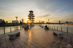 Lookout (kiatography1) Tags: city bridge sunset urban sun lighthouse tower water architecture clouds star landscapes singapore warm waterfront outdoor sony cityscapes lookout human tiles elements land sunburst rays burst element scapes urbanscapes sunstar tanjongrhu humanelement a7r sonya7r
