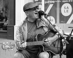 A busker singing the blues. (MAMF photography.) Tags: street city uk greatbritain summer england people blancoynegro blanco monochrome sex photography town photo google nikon flickr noir singing image noiretblanc zwartwit unitedkingdom guitar britain negro north leeds july singer gb vocalist busker upnorth zwart pretoebranco schwarz guitarist westyorkshire onthestreet briggate flickrcom greatphoto googleimages northernengland enblancoynegro ls1 zwartenwit greatphotographers mamf inbiancoenero leedscitycentre blancoenero schwarzundweis nikond7100 mamfphotography