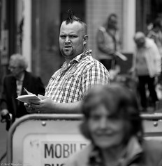 Focus on what realy matters. (Neil. Moralee) Tags: life street uk boy people blackandwhite bw white man black monochrome face field shirt work hair check nikon focus faces zoom outdoor candid working neil depthoffield devon mohawk spike mon spikey depth everydaylife teignmouth 18300mm d7100 moralee neilmoralee teignmouth2016neilmoralee