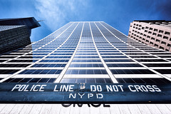 Do not cross the police (Blende57) Tags: highrise officetower skyscraper manhattan sky bluesky lowangle wideangle architecture newyork ny nyc usa police policeline