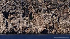Little Sails Under A Big Cliff (Sailor Alex) Tags: italy boat sailboat sloop vessel sardinia yachting cruising cruisers yacht sea sailing