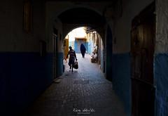 in the heart of the old medina. (Karim Achalhi) Tags: oldmedina tanger people story inspiration street photojournalism streetphotography shadow blue door darknesse daylight traveler canon6d morocco creativity ramadan 2016 mg8678 northofmorocco