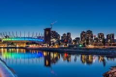 Vancouver at night (maestro17ca) Tags: downtown vancouver vista view nightscape evening bluehour britishcolumbia condos cityscape city coastline canada bcplacestadium bc architecture nightphotography longexposure twilight reflection waterfront blue skyline skyscrapers sonya6000 harbourcenter vancouveratnight