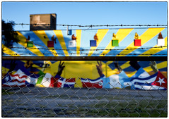 West Side Mural (paulh192) Tags: grandrapids michigan grandvilleave westside mural hispanic culture art bright colorful building fence chainlink barbedwire leica