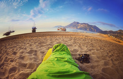 Person sleeping on beach,Cirali Turkey (marozn) Tags: fatigued morning protection sleeps single relaxation mountains beach clear turkey boats ship person cosy warm coast asleep nature mountain bag sand fatigue relaxing sunset lying hike hiking sea man ocean olympos outdoor coastal shore camper water sunrise camping outdoors one outside sleeping adult colorful warmth sandy peace colourful fisheye